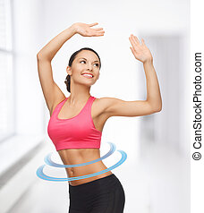 sporty woman in aerobic or dance movement - beautiful sporty...