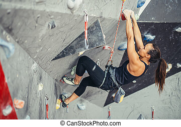sporty woman in boulder climbing hall - Sporty strong young...