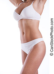 Sporty woman in lingerie on white background