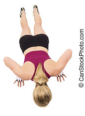 Sporty woman is doing pushups, isolated on white background.