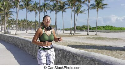 Sporty woman jogging in park - Athletic young woman in...