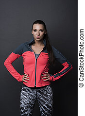 Sporty woman on black background