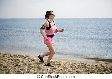 Sporty woman on the beach