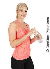 Sporty woman opening bottle of water