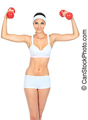 sporty woman - Shot of a sporty young woman with dumbbells. ...