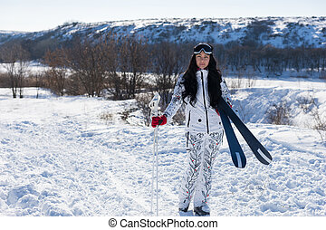 Sporty Woman Skier Posing at the Snow
