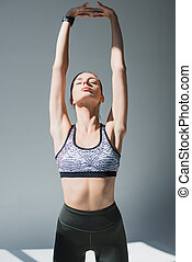 sporty woman stretching hands