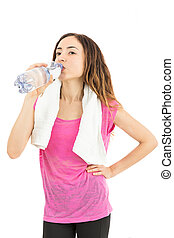 Sporty woman thirsty and drinking water