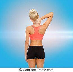 sporty woman touching her neck - fitness, healthcare and...