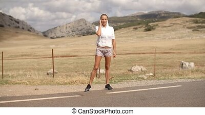 Sporty Woman Warming Up Before Her Run on Mountain Spanish...