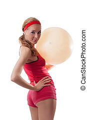 Sporty woman with fitness ball