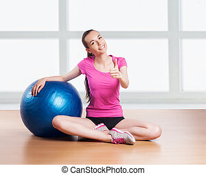 Sporty Woman with Fitness Ball.