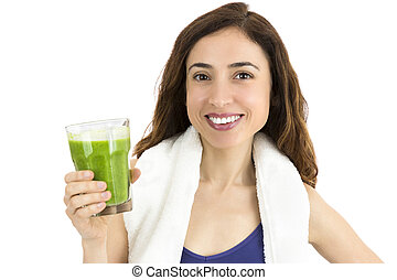 Sporty woman with green smoothie