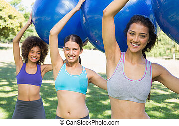 Sporty women exercising with fitness balls