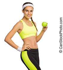 Sporty young girl with apple