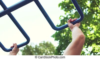 Sporty Young Man Training Outdoors in Summer Sunny Park