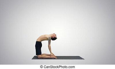 male yoga teacher in heron pose intense hamstring stretch