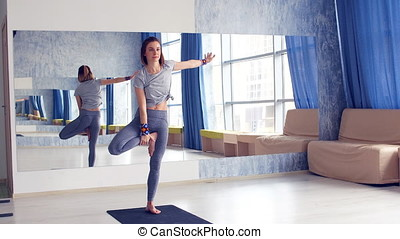 Sporty young woman doing yoga practice - concept of healthy...