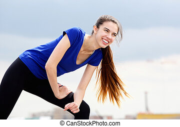 Sporty young woman enjoying workout routine