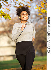 Sporty young woman jogging in the park
