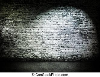 Spot light on old brick wall
