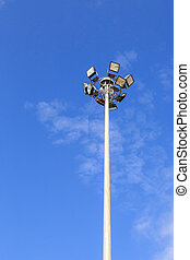Spot light pole with blue sky in the park