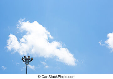 Spot light pole with blue sky in the stadium