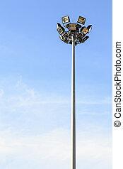 Spot light pole with blue sky in the stadium