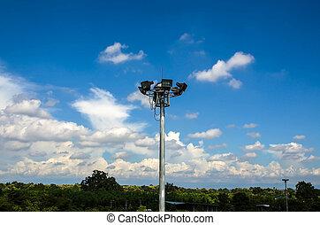 Spot light pole with blue sky