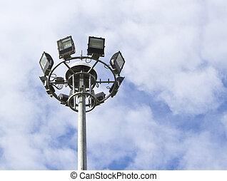 Spot-light tower in blue sky