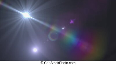 Spot of light and lens flare against black background - ...