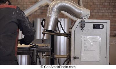 Spot welding machine Industrial automotive part in factory. ...