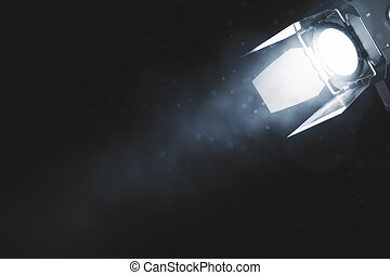 Spotlight on smoky background with copyspace