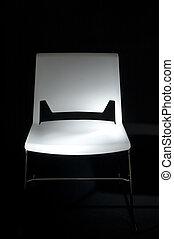 Spotlight on White Chair