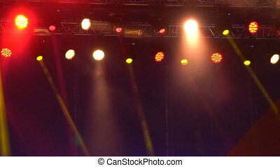 Spotlights and lighting equipment above the stage