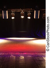 Spotlights in theatre - Colorful spotlights shining through...