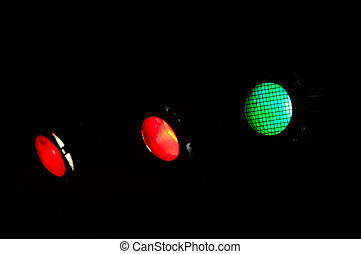 Spotlights on a dark background. The main focus is on the...