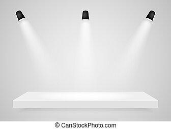 Spotlights shine on the platform