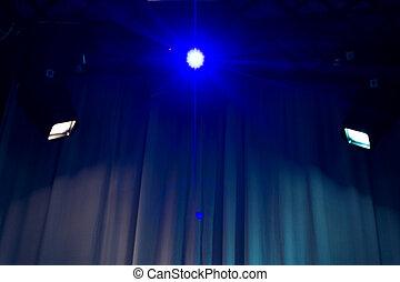 Spotlights shining on an empty venue