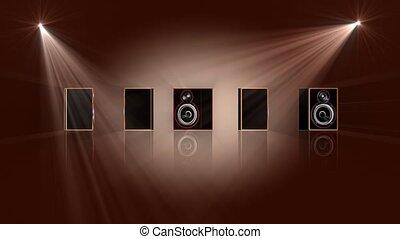 Spotlights shining on stereo speakers