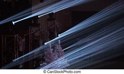Spotlights - Thin beams of searchlights on a Christmas scene