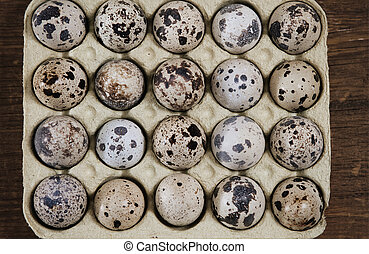 Spotted eggs on wooden background