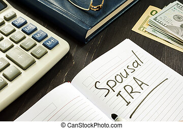 Spousal IRA inscription in the note. Retirement concept.