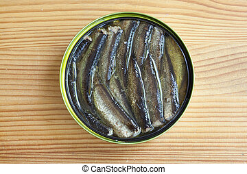 sprats on a wooden table