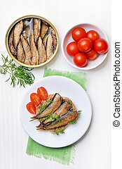Sprats sandwich and tomatoes