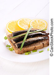 Sprats sandwich on white plate