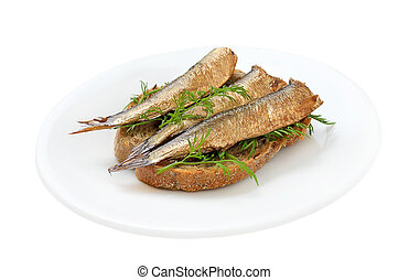 Sprats sandwiches on a plate