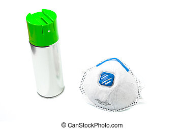 Spray can and surgical mask - Unlabelled metal spray can...