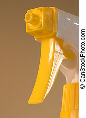 Yellow spray nozzle, macro of the nozzle and trigger.