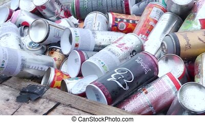 Spray paint can - Pan over an upturned couch, filled with...